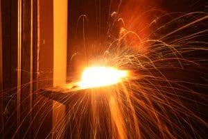 Antique Single Sided Spot Welder - photo of a blacksmith hammering hot metal together
